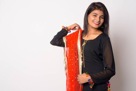 Happy young Persian woman smiling in traditional clothing Stock Photo