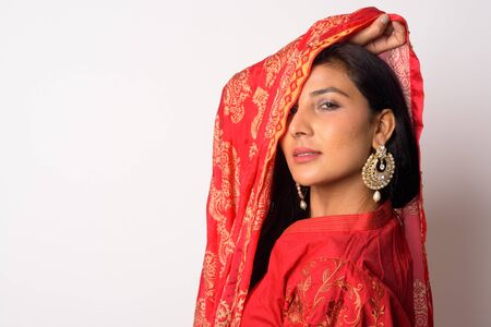 Face of young beautiful Persian woman in traditional clothing Stock Photo