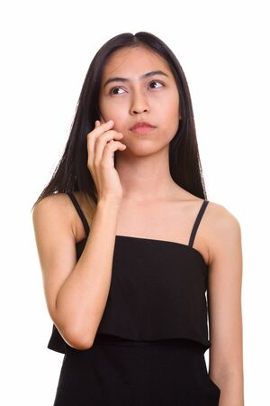 Rozważna młoda azjatycka nastolatka rozmawia przez telefon komórkowy Zdjęcie Seryjne