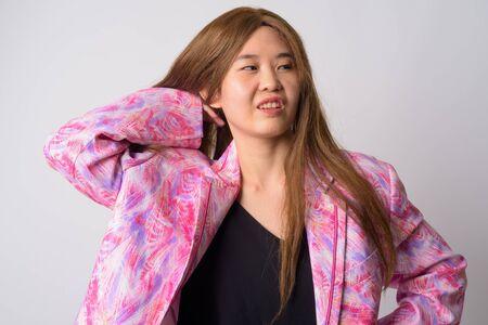 Portrait of proud businesswoman with wig flipping hair Banco de Imagens
