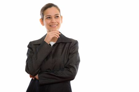 Studio shot of young happy businesswoman smiling and thinking wh