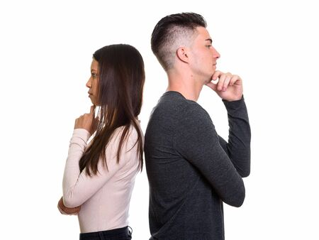 Profile view of young couple thinking together back to back