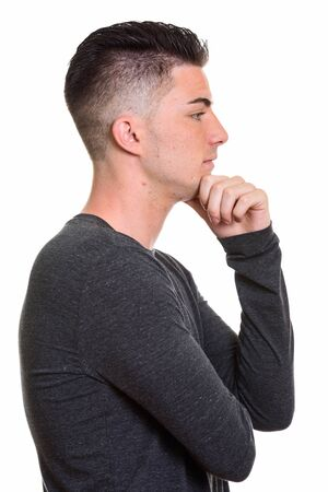 Profile view of young handsome man thinking