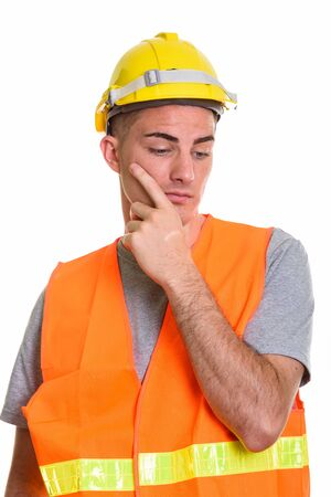 Construction worker thinking and planning while looking down