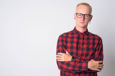 Portrait of young blonde hipster man with arms crossed