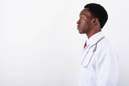 Young handsome African man doctor against white background 免版税图像