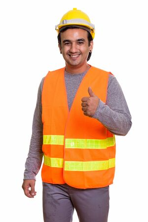 Happy Persian man construction worker smiling while giving thumbs up