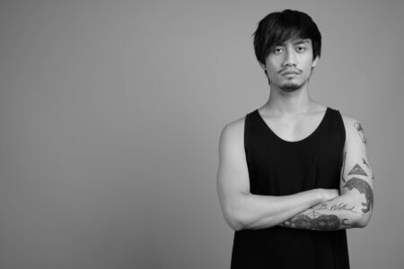 Portrait of young Asian man in black and white Stock Photo