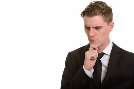 Face of young handsome blonde businessman in suit