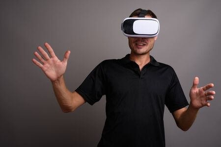 Portrait of handsome man using virtual reality headset