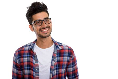 Portrait of young bearded Persian hipster man with eyeglasses