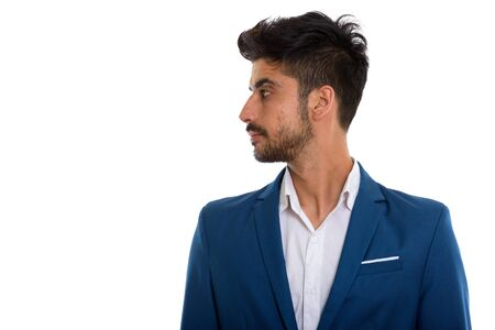 Young handsome bearded Persian businessman in suit