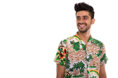 Young handsome bearded Persian tourist man ready for vacation Stockfoto