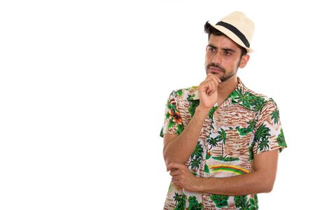 Young handsome bearded Persian tourist man ready for vacation Zdjęcie Seryjne