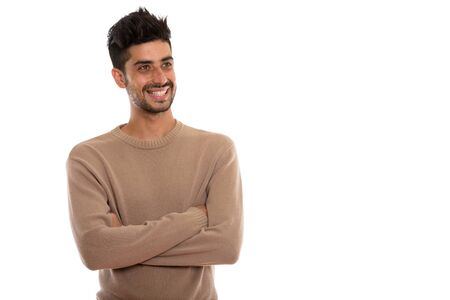 Studio shot of young happy Persian man smiling and thinking with