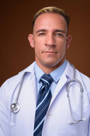 Face of man doctor against brown background