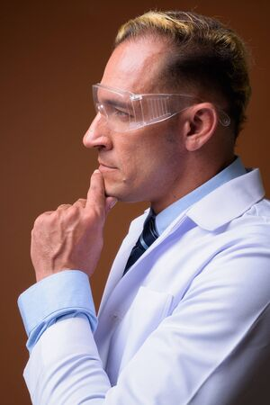 Profile view of man doctor wearing protective glasses