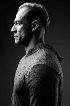 Profile view of muscular man in black and white