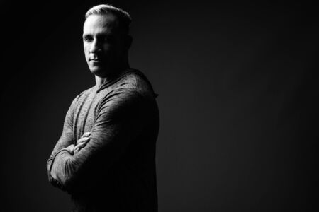 Studio shot of muscular man in black and white 写真素材