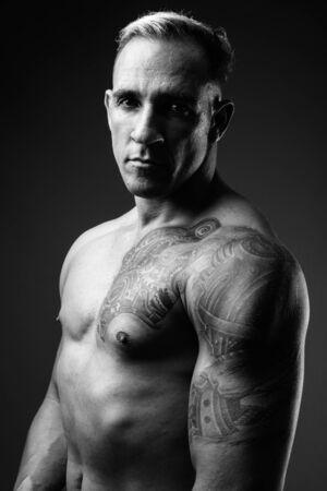 Studio shot of muscular man shirtless in black and white