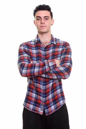 Portrait of young handsome hipster man with arms crossed