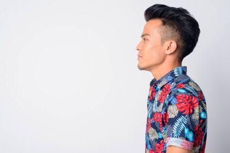 Closeup profile view of young Asian man