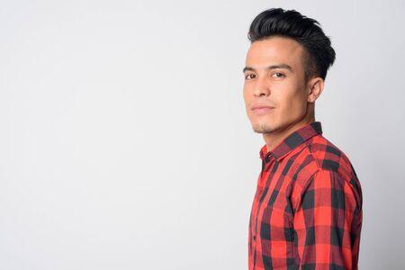 Closeup profile view of young Asian hipster man looking at camera