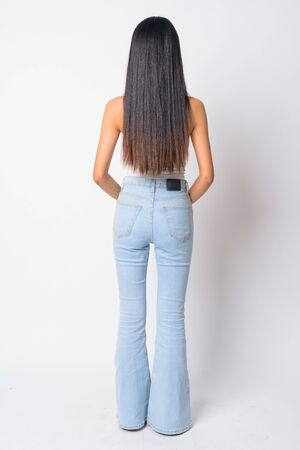 Full body shot rear view of young Asian woman
