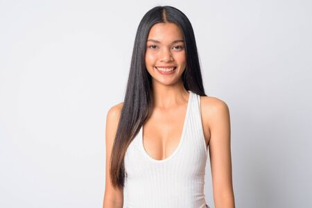 Portrait of happy young beautiful Asian woman smiling