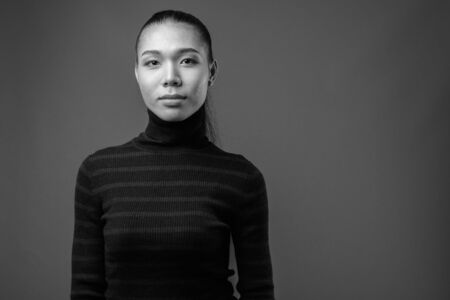 Young beautiful Asian transgender woman in black and white