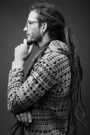 Young handsome Hispanic man with dreadlocks in black and white Reklamní fotografie