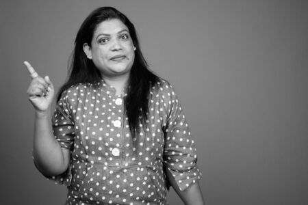Portrait of mature Indian woman in black and white