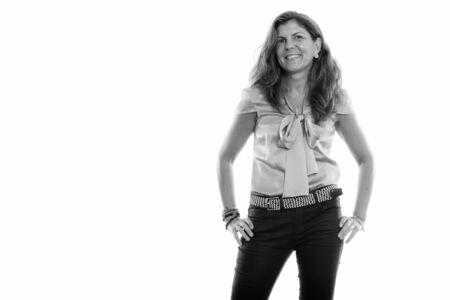 Studio shot of mature happy woman smiling and posing