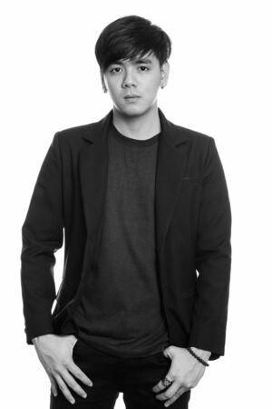 Studio shot of cool handsome Asian businessman