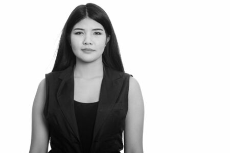 Studio shot of young Asian woman in black and white