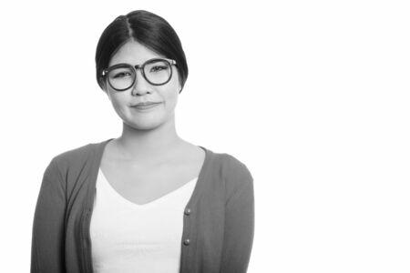 Studio shot of young Asian nerd woman