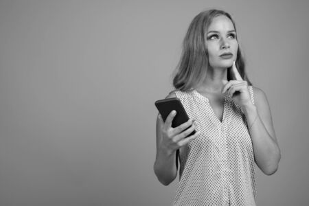 Young beautiful businesswoman with blond hair in black and white 스톡 콘텐츠