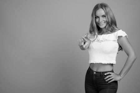 Young beautiful woman with blond hair in black and white