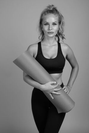 Young beautiful woman ready for gym in black and white