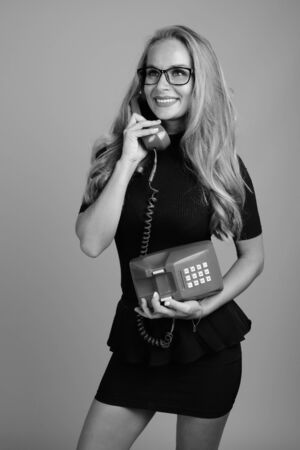 Young beautiful businesswoman with eyeglasses in black and white
