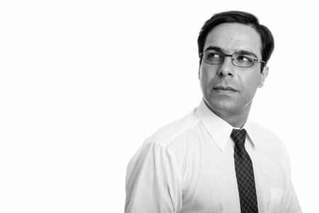 Close up of young Persian businessman thinking with eyeglasses isolated against white background