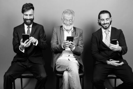 Portrait of multi ethnic bearded businessmen together Stock Photo