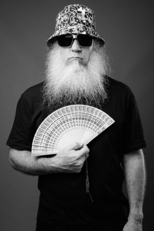 Mature man with long white beard in black and white Фото со стока