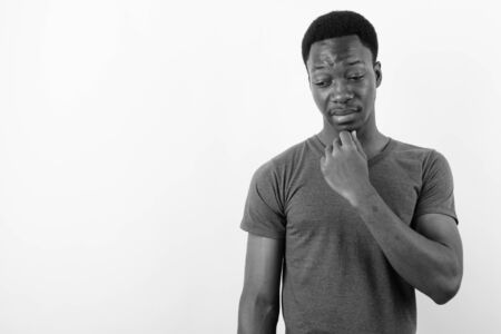 Young handsome African man against white background