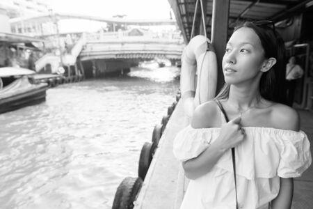 Young beautiful tourist woman exploring the city of Bangkok