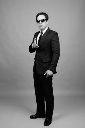 Portrait of handsome Persian businessman in suit 免版税图像