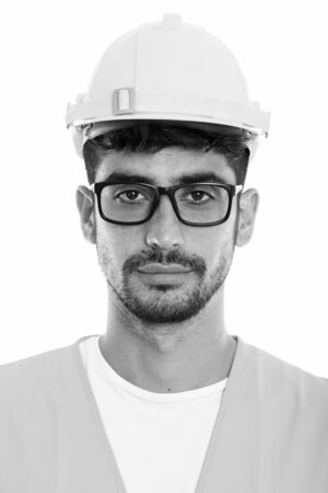 Face of young Persian man construction worker wearing eyeglasses
