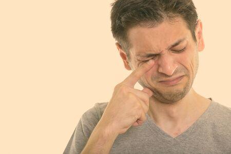 Close up of sad young man crying