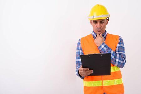 Portrait of mature Persian man construction worker Banco de Imagens