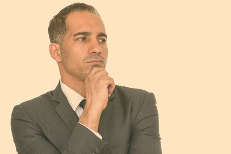 Face of stressed mature Persian businessman thinking